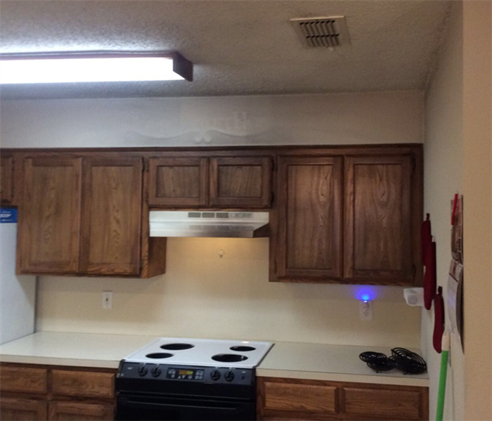 fire damages cabinets in apartment kitchen
