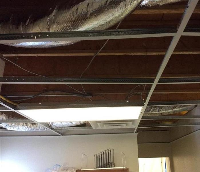 fallen ceiling tiles and bare studs