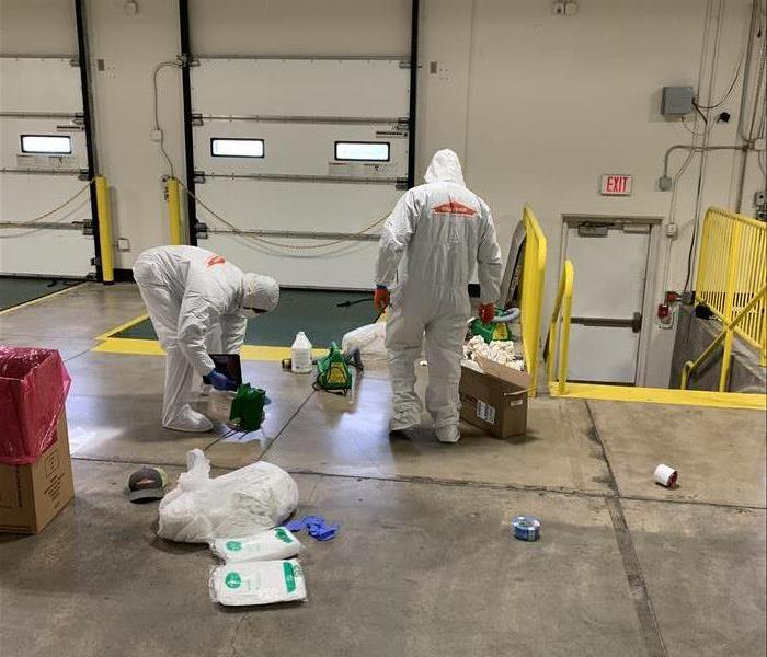 warehouse men in white PPE