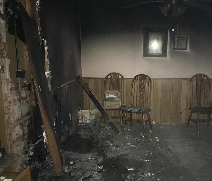 fire damaged wall, chairs