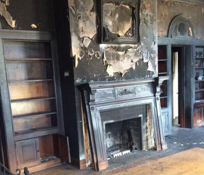 burned fireplace and artwork