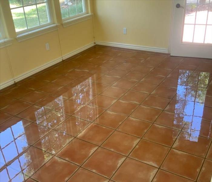 water on tile floor