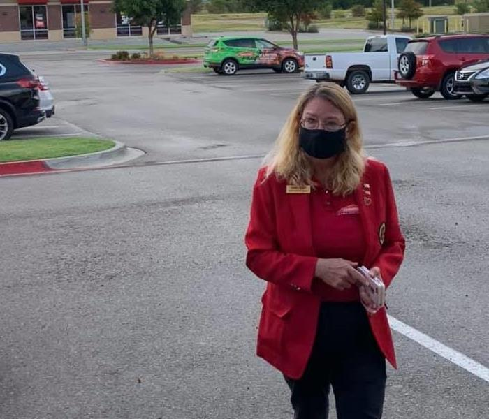 Woman in red coat in parking lot