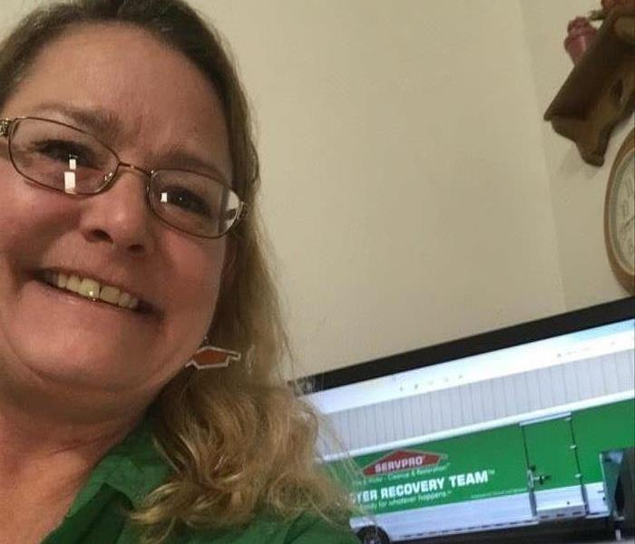 lady in green shirt, computer